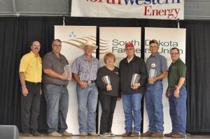 2014 Rural Dakota Pride honorees recognized during the 2014 Farmers Union Day at the South Dakota State Fair; (L to R): Wayne Soren, SDFU Vice President; John Wheeting, Hub Kieser, Cindy Wilk, Alan Vedvei, Nick Nemec and Doug Sombke, SDFU President.